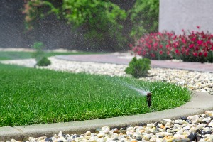residential sprinkler system in Bloomington IL watering a yard