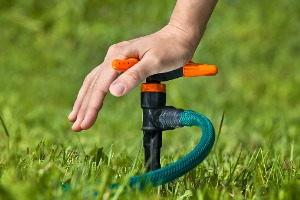 A Hand Testing Out a Sprinkler Installation for Springfield IL
